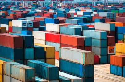 lots-of-cargo-freight-containers-PQYTC9D-scaled-405x266-min